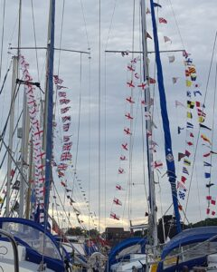 Masts decorated with colourful bunting
